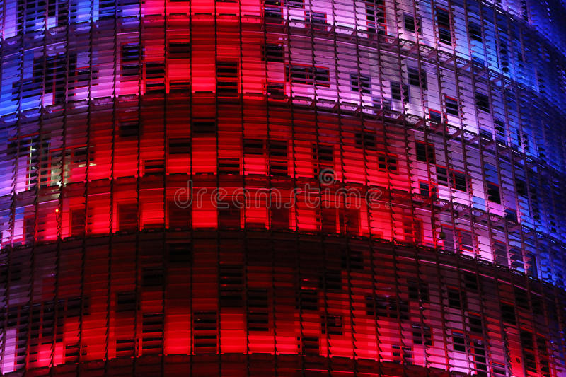 Torre Agbar by night. Torre Agbar - skyscraper in Barcelona royalty free stock image