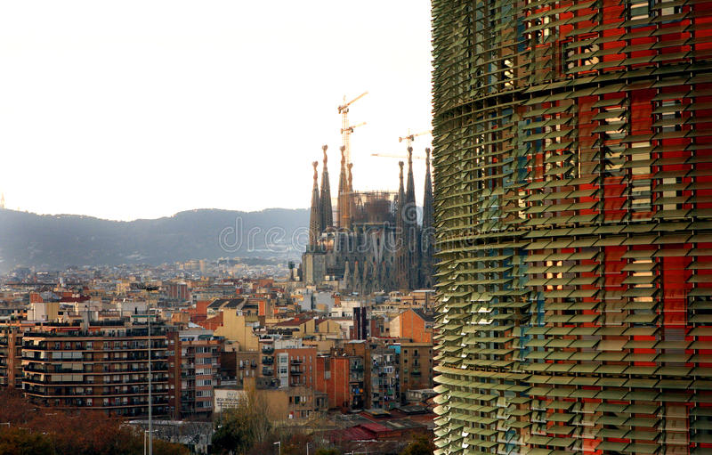 TORRE AGBAR -Sagrada Familia - Barcelona. The Torre Agbar is a 38-story skyscraper / tower located between Avinguda Diagonal and Carrer Badajoz, near Plaça de royalty free stock images