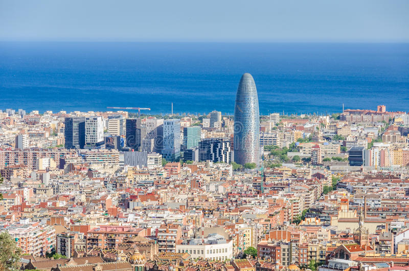 Torre Agbar from Turo del Rovira in Barcelona, Spain. The view of Torre Agbar and surroundings from the hill of Turo del Rovira in Barcelona, Catalonia, Spain stock image