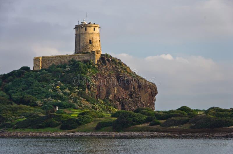 Torre Coltellazzo del faro di Efisio del san a Nora, Sardegna, Italia immagini stock libere da diritti