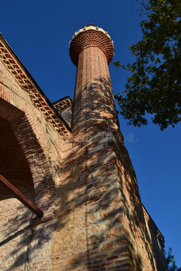 A torre da mesquita vermelha imagem de stock royalty free