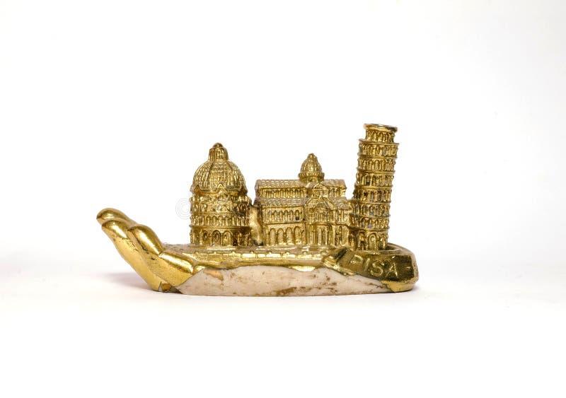 Torre de Pisa en la mano/Italia del oro imagenes de archivo