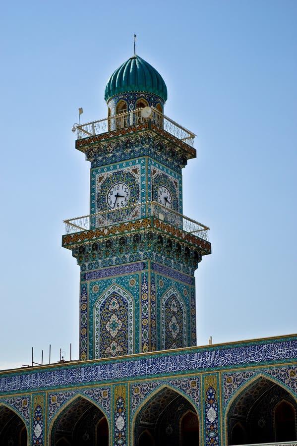 Torre de reloj del faro en mezquita del al-Kadhimiya imagen de archivo libre de regalías