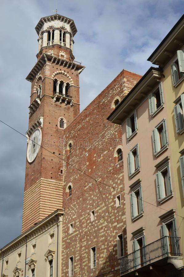 3 Torre dei Lamberti. Piazza delle Erbe Verona Italy. The Torre dei Lamberti on Piazza delle Erbe is an 84 m high tower in Verona, northern Italy stock images
