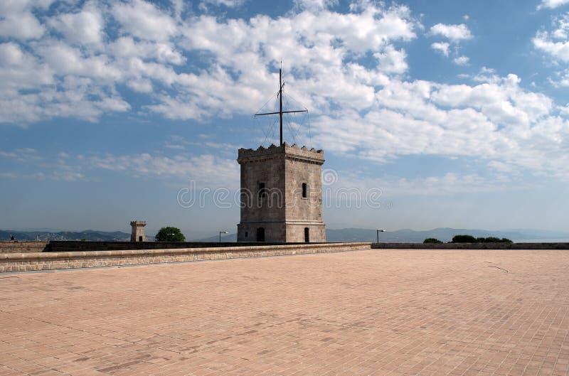 Torre del castello di Montjuic con il telegrafo ottico immagini stock
