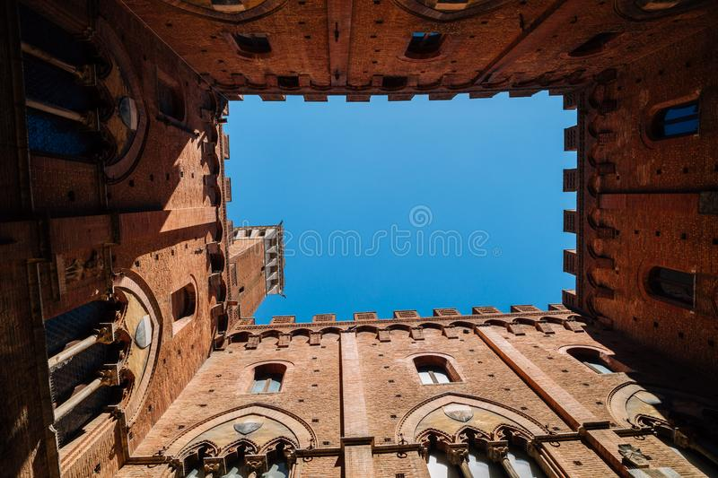 Torre del Mangia tower at Palazzo Pubblico in Siena, Italy stock images
