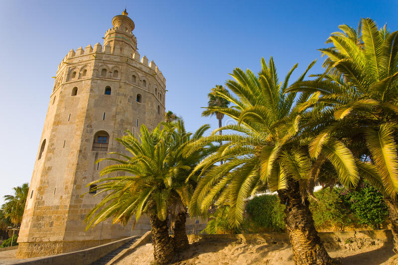 Torre del Oro. The Torre del Oro (English: Gold Tower) is a dodecagonal military watchtower in Seville, southern Spain, built by the Almohad dynasty in order to royalty free stock images