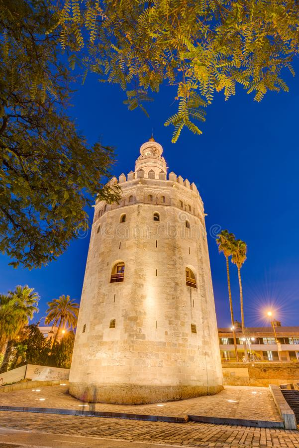 The Torre del Oro tower in Seville, Spain. The Torre del Oro in Seville is an albarrana tower located on the left bank of the Guadalquivir River. It houses the royalty free stock photo