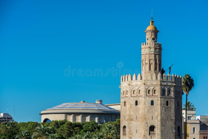 The Torre del Oro tower in Seville, Spain. The Torre del Oro in Seville is an albarrana tower located on the left bank of the Guadalquivir River. It houses the royalty free stock image
