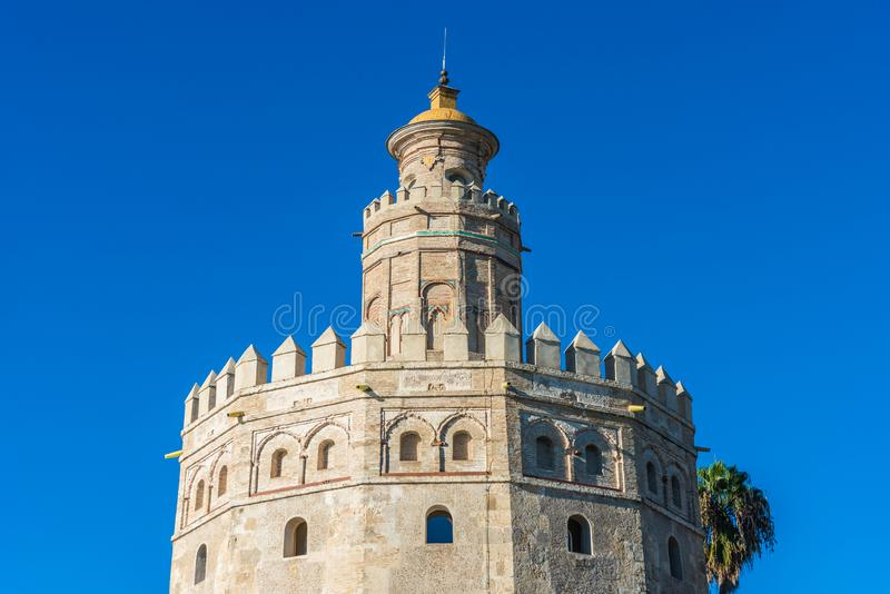 The Torre del Oro tower in Seville, Spain. The Torre del Oro in Seville is an albarrana tower located on the left bank of the Guadalquivir River. It houses the stock photo