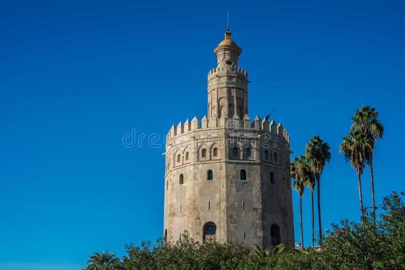 The Torre del Oro tower in Seville, Spain. The Torre del Oro in Seville is an albarrana tower located on the left bank of the Guadalquivir River. It houses the stock photography