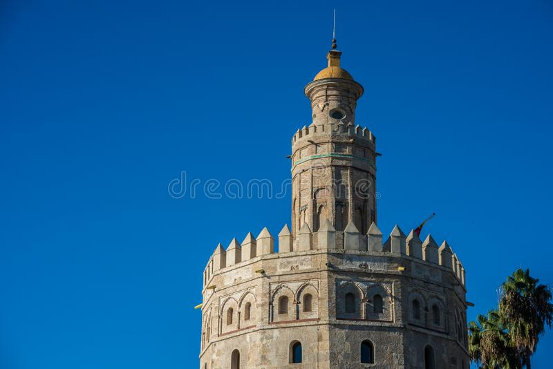 The Torre del Oro tower in Seville, Spain. The Torre del Oro in Seville is an albarrana tower located on the left bank of the Guadalquivir River. It houses the stock image
