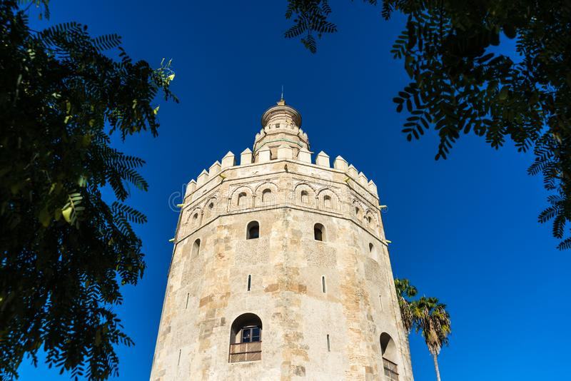 The Torre del Oro tower in Seville, Spain. The Torre del Oro in Seville is an albarrana tower located on the left bank of the Guadalquivir River. It houses the stock photos