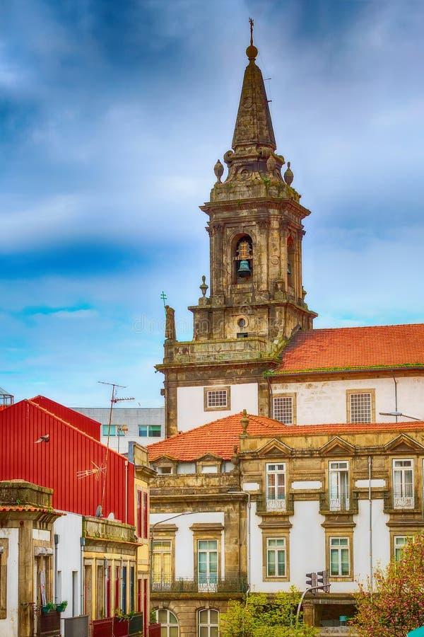 Torre di chiesa di Oporto, Portogallo Trindade immagini stock