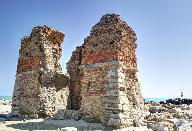Torre Flavia. The ruins of Torre Flavia, an ancient roman tower on the beach of Ladispoli, near Rome, Italy stock images