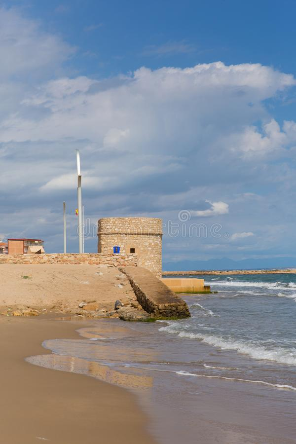 Torre la mata Spain historic 14th century watch tower on the seafront. Torre del Embarcadero historic 14th century watch tower on La Mata promenade royalty free stock photos