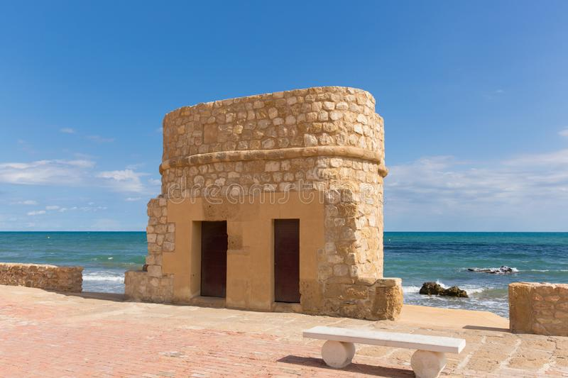Torre la mata Spain watch tower on the seafront. Torre del Embarcadero historic 14th century watch tower on La Mata promenade stock photo