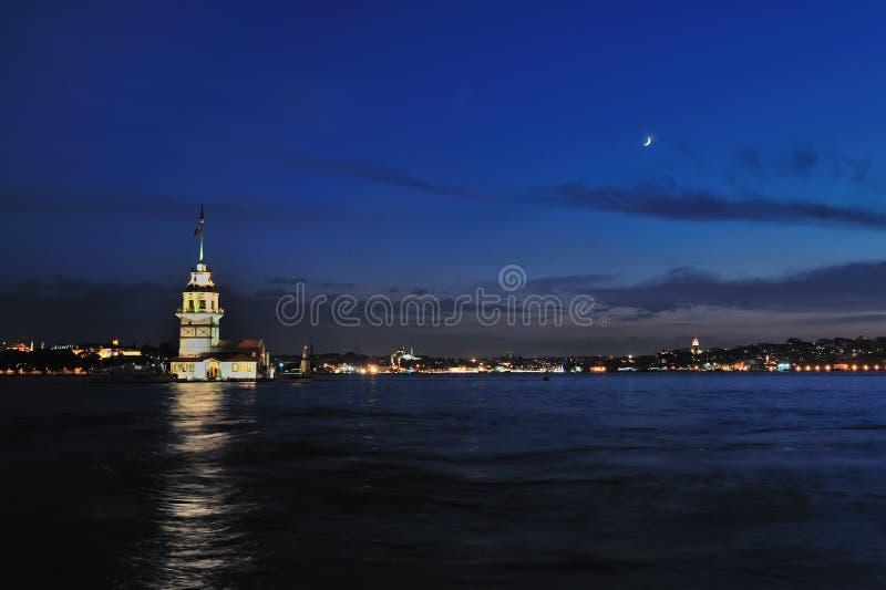 Torre nova com lua imagens de stock