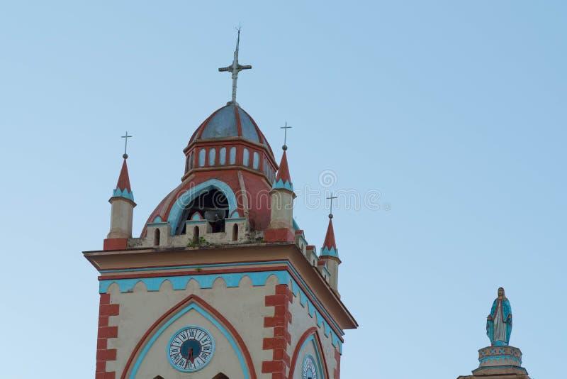 Torre y santo foto de archivo