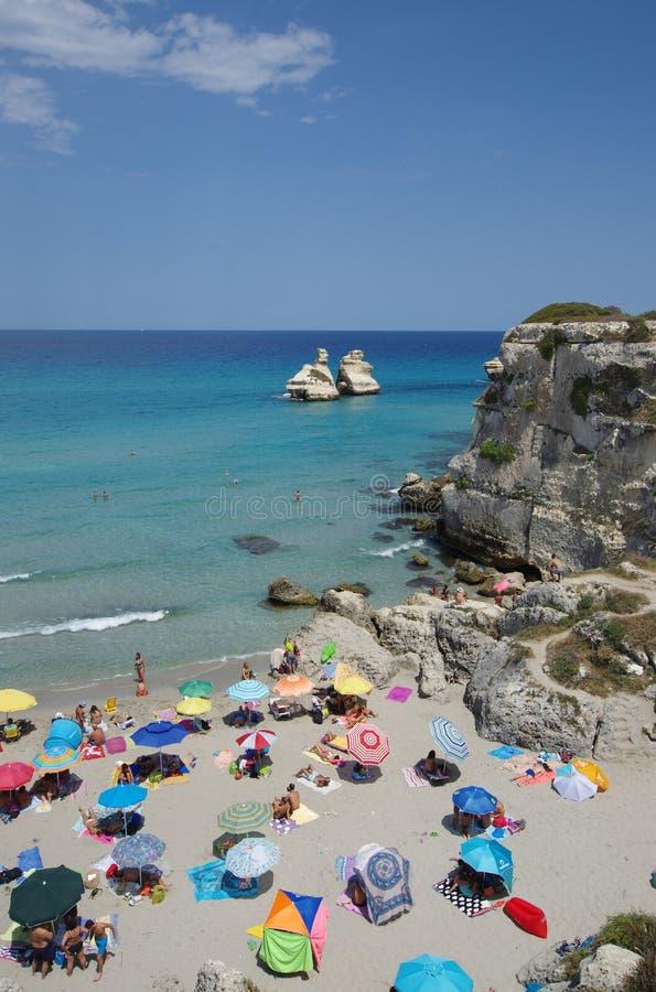 Torredell het strand van Orso, Italië stock afbeeldingen