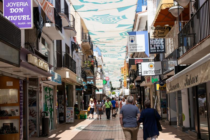 TORREMOLINOS, SPAIN, Andalusia, Costa del Sol - May 21, 2019. Shopper and tourists are walking along most popular street in old stock photo