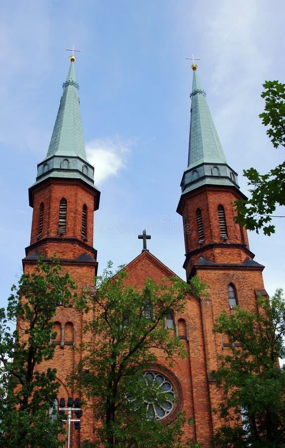 Torres de iglesia góticas en Pruszkow foto de archivo libre de regalías