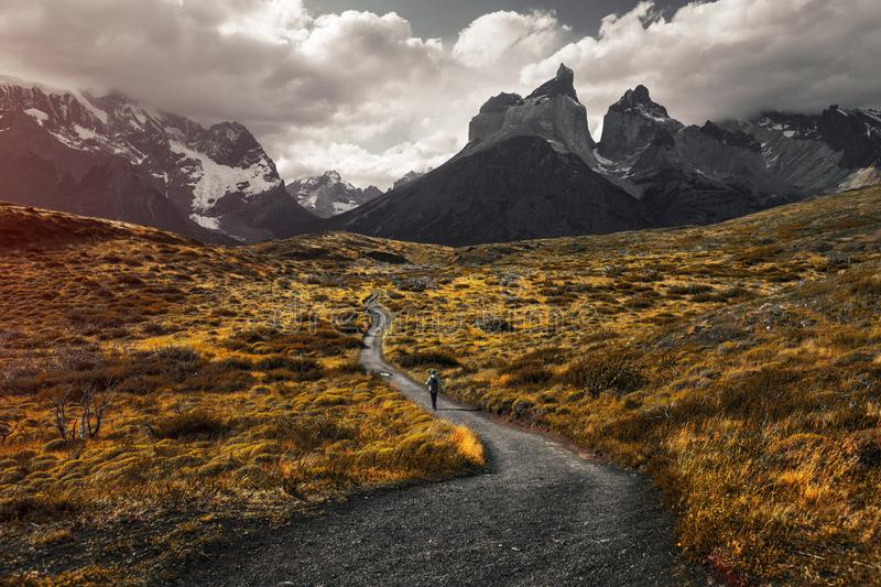 Torres del Paine National Park. Woman hiker walks on the trail in Torres del Paine National Park, Chilean Patagonia stock image