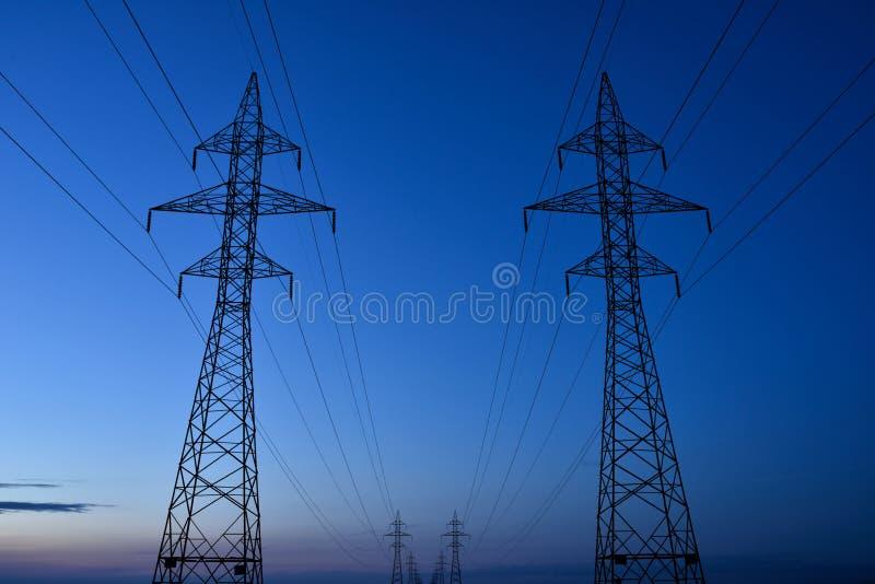 Torres eléctricas de la transmisión imagen de archivo libre de regalías