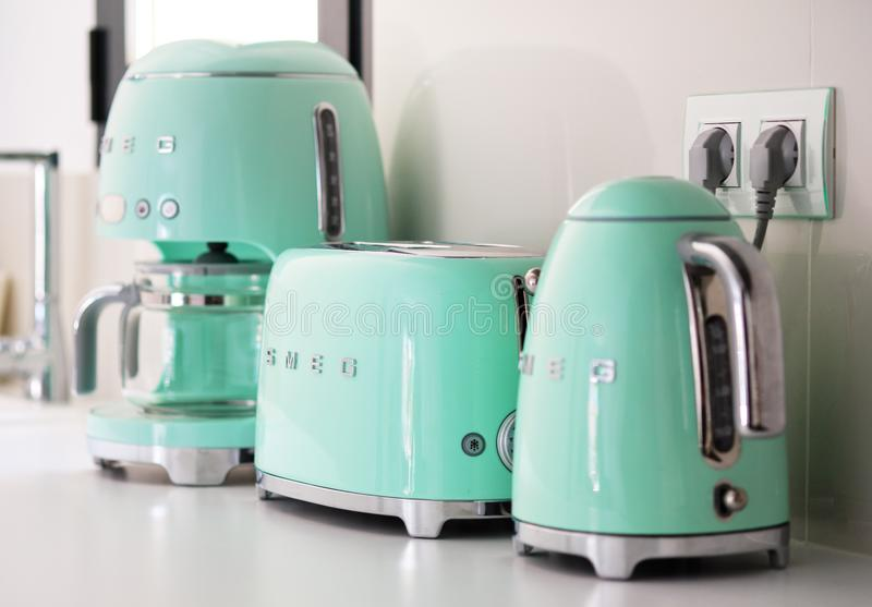 Torrevieja, Spain - June1, 2019: On kitchen counter top closeup in row SMEG brank kitchen appliances for easy life, coffee maker royalty free stock image