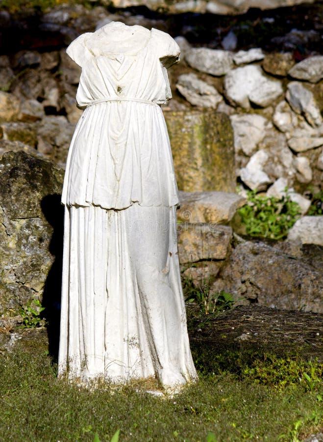 Torso arcaico grego da estátua fotos de stock