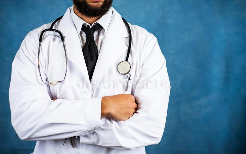 Torso of a confident doctor with stethoscope stock photography