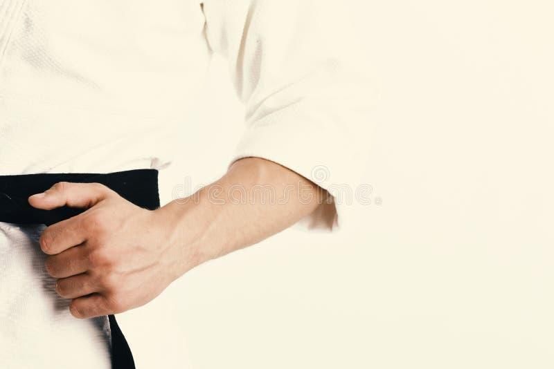 Torso maschio e armi allegre su fondo bianco fotografie stock
