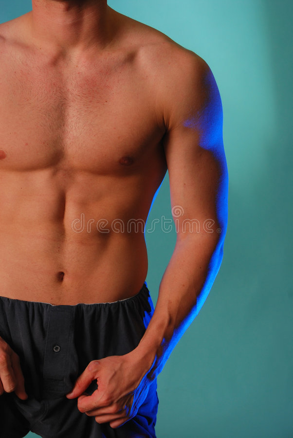 Torso maschio magro in azzurro fotografia stock