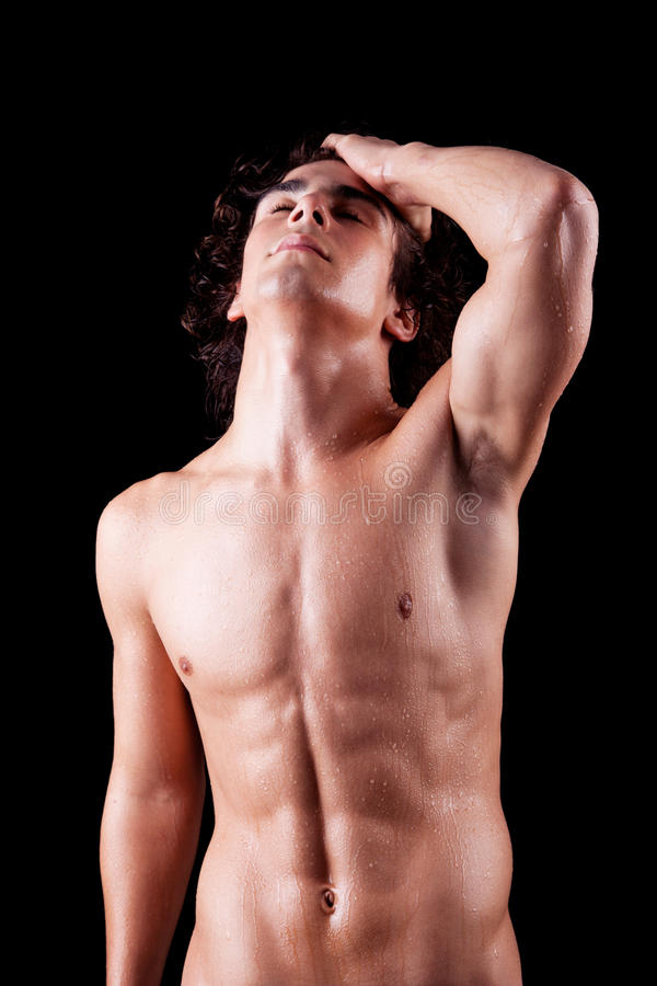 Torso of a sweat man in topless,. Isolated on black. Studio shot stock photos