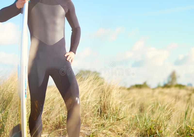 Torso view of a fit muscular surfer royalty free stock image