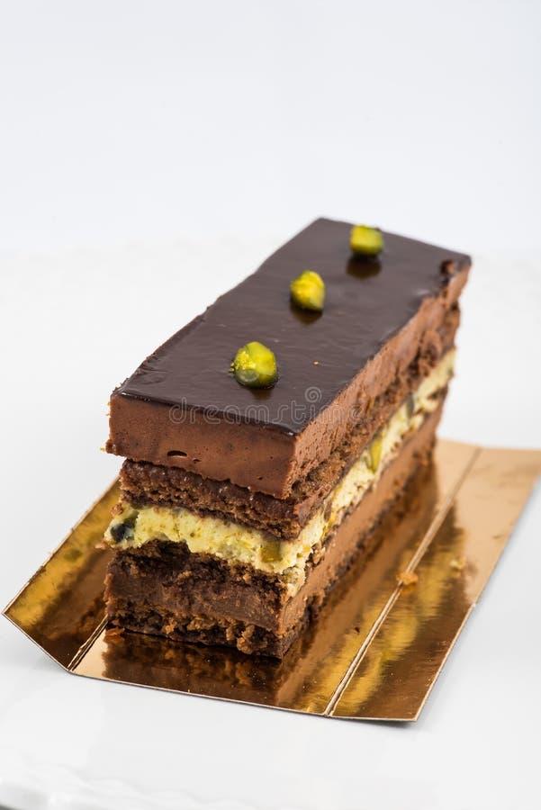 Torta acodada del chocolate y del pistacho fotos de archivo