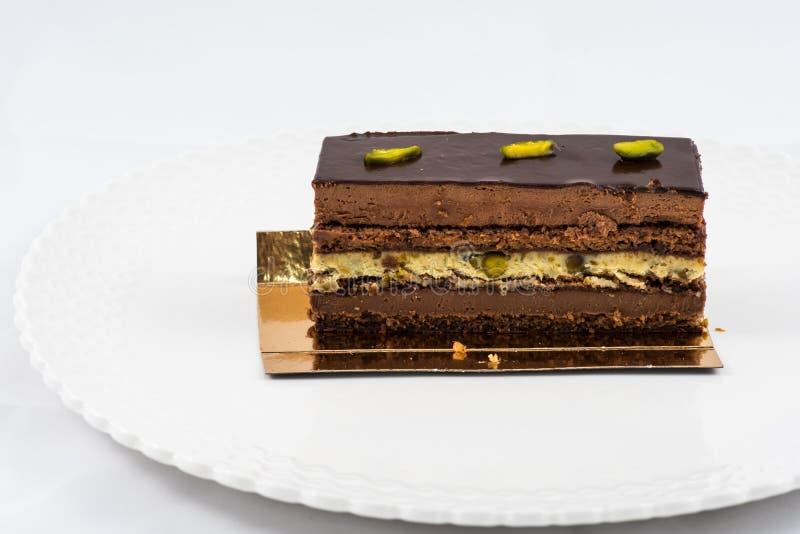 Torta acodada del chocolate y del pistacho fotografía de archivo libre de regalías