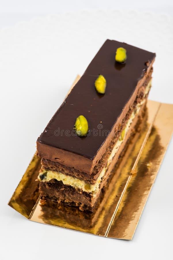 Torta acodada del chocolate y del pistacho fotografía de archivo