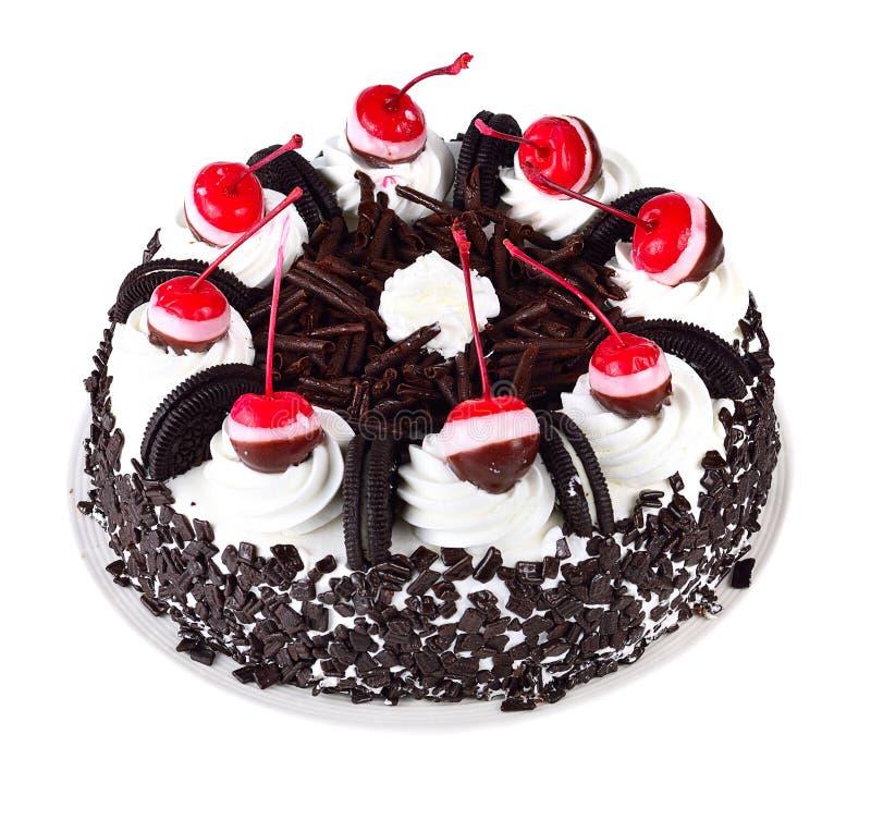 Torta de chocolate aislada en el fondo blanco imagenes de archivo