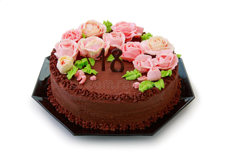 Torta de chocolate con las rosas de la crema de la mantequilla para el décimo octavo cumpleaños foto de archivo libre de regalías