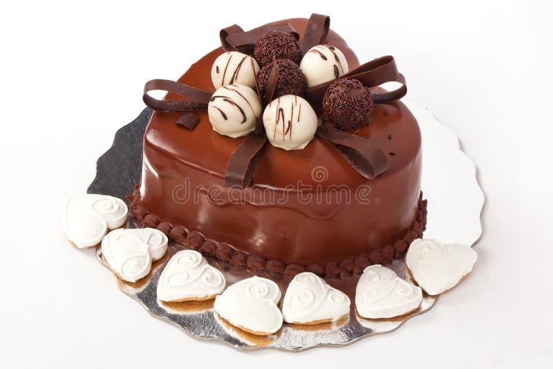 Torta de chocolate en dimensión de una variable del corazón imagen de archivo
