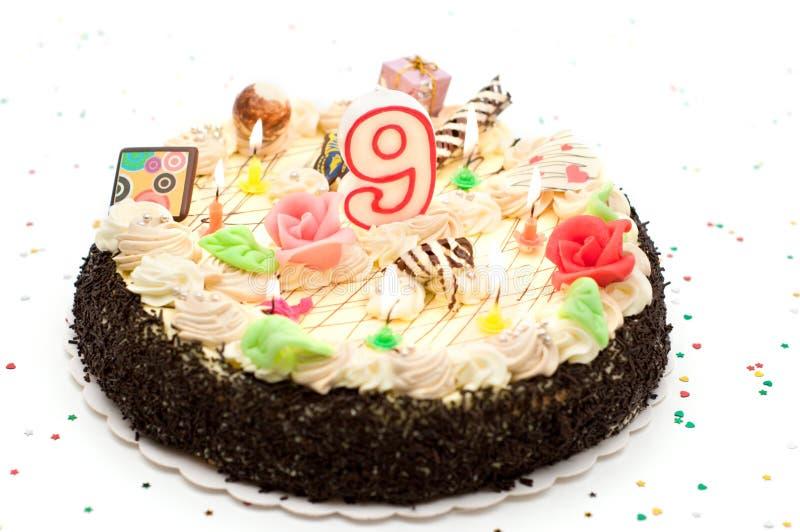 Torta de cumpleaños 9 años fotos de archivo libres de regalías