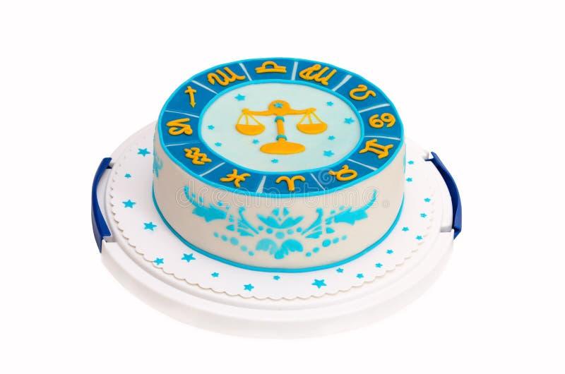 Torta de cumpleaños con símbolos y el libra del zodiaco imagenes de archivo