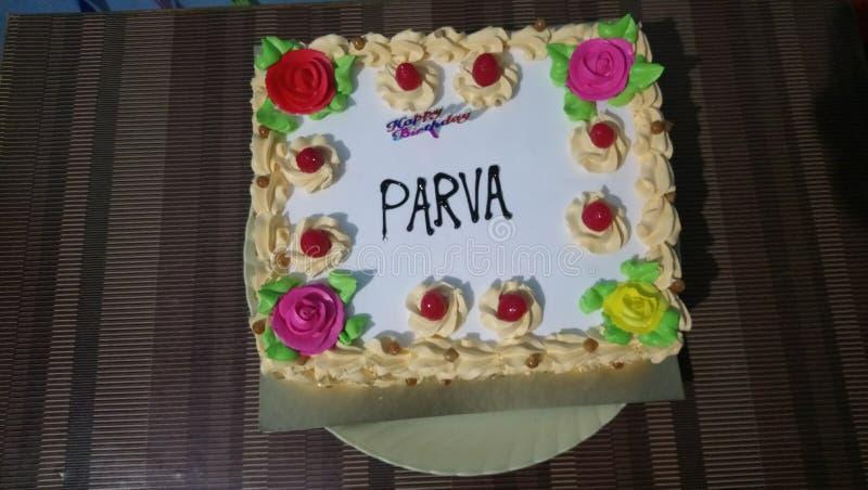 Torta de cumpleaños para la niña y el muchacho imagenes de archivo