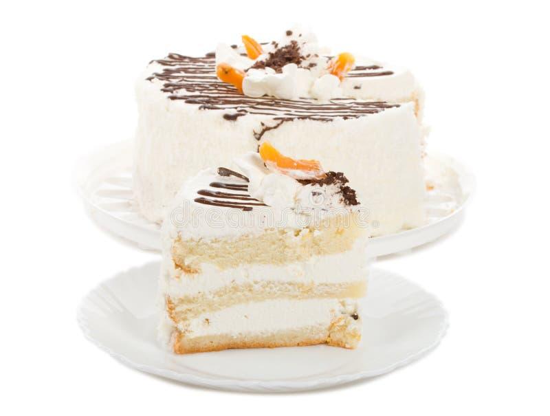 Torta de la galleta con crema y albaricoques secados foto de archivo