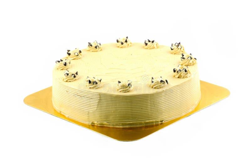 Torta de la mantequilla de la vainilla aislada en blanco. fotos de archivo libres de regalías