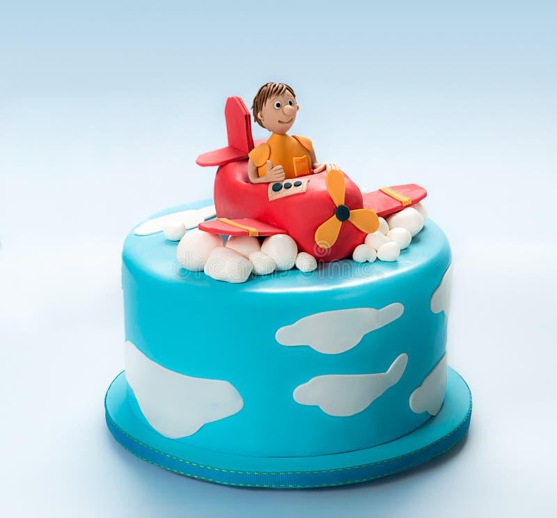 Torta de la pasta de azúcar de un aeroplano y de un piloto fotografía de archivo libre de regalías