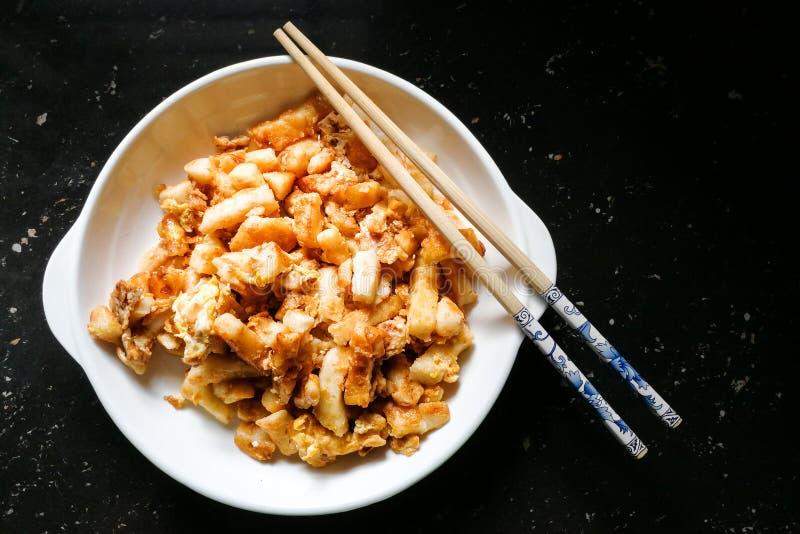 Torta de zanahoria o Cai Tau Kueh frita, delicadeza popular de Malasia foto de archivo libre de regalías