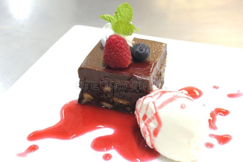 Download Torta Del Brownie Con La Salsa De La Frambuesa Imagen de archivo - Imagen de hielo, oscuro: 42436993