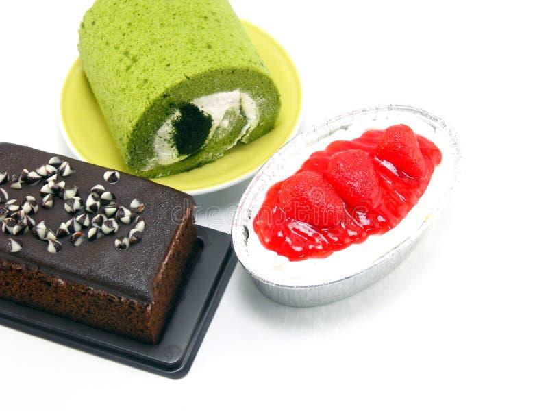 Torta del rollo del té verde del pastel de queso de la fresa y torta de chocolate imagen de archivo
